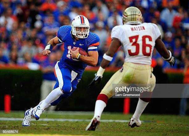 Tim Tebow of the Florida Gators runs for yardage against Dekoda Watson of the Florida State Seminoles at Ben Hill Griffin Stadium on November 28 2009...