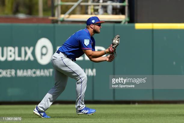 Tim Tebow of the Mets makes a catch in short left field during the spring training game between the New York Mets and the Detroit Tigers on March 01...
