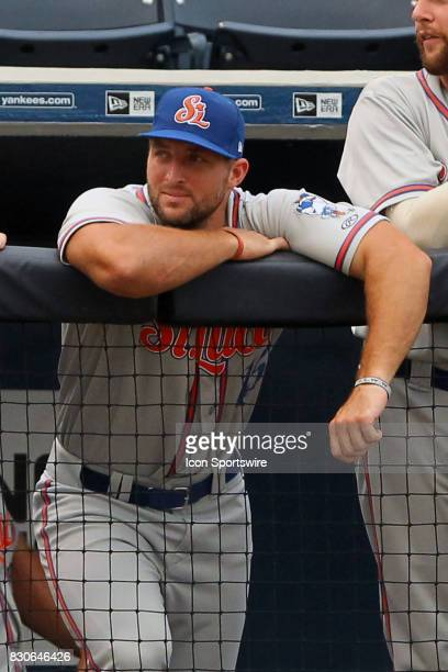 Tim Tebow of the Mets watches the action from the dugout during the Florida State League game between the St Lucie Mets and the Tampa Yankees on...