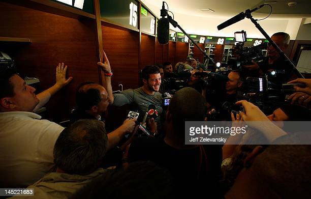 Tim Tebow of the New York Jets speaks to reporters after an organized team activity at the New York Jets Atlantic Health Jets Training Center on May...