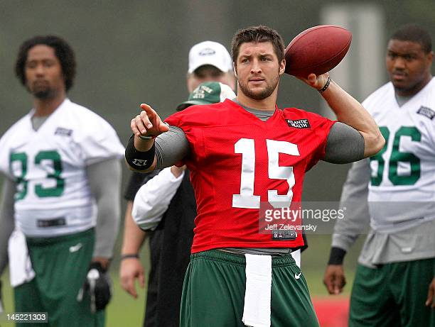Tim Tebow of the New York Jets work out at an organized team activity at the New York Jets Atlantic Health Jets Training Center on May 24 2012 in...