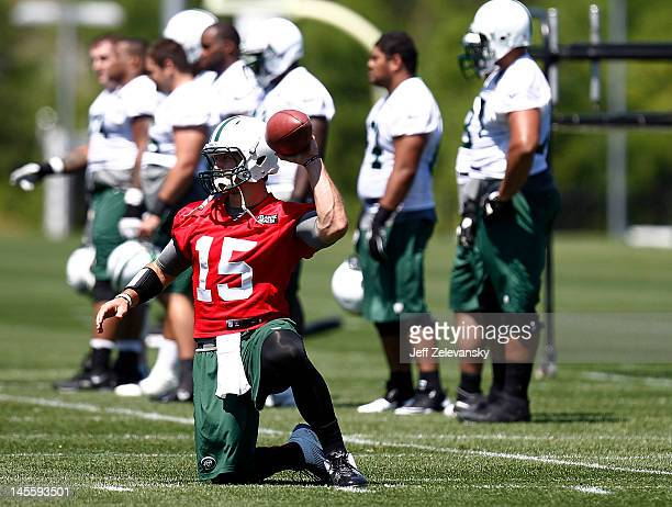 Tim Tebow of the New York Jets works out at an organized team activity at the New York Jets practice facility on May 24 2012 in Florham Park New...