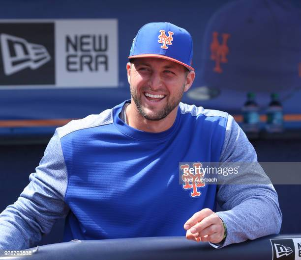 Tim Tebow of the New York Mets looks on from the dugout at the start of the spring training game against the New York Yankees at First Date Field on...