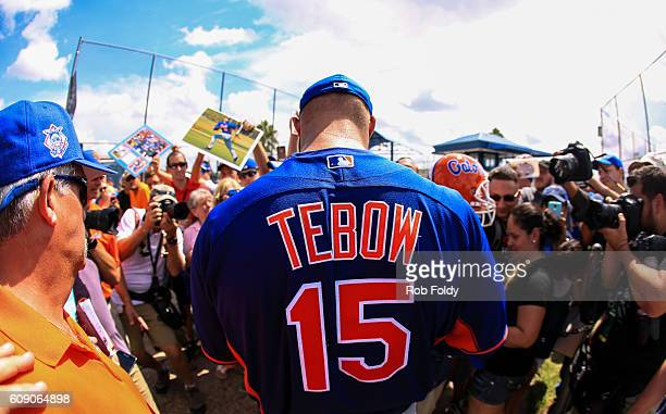 Tim Tebow of the New York Mets signs autographs after a work out at an instructional league day at Tradition Field on September 20 2016 in Port St...