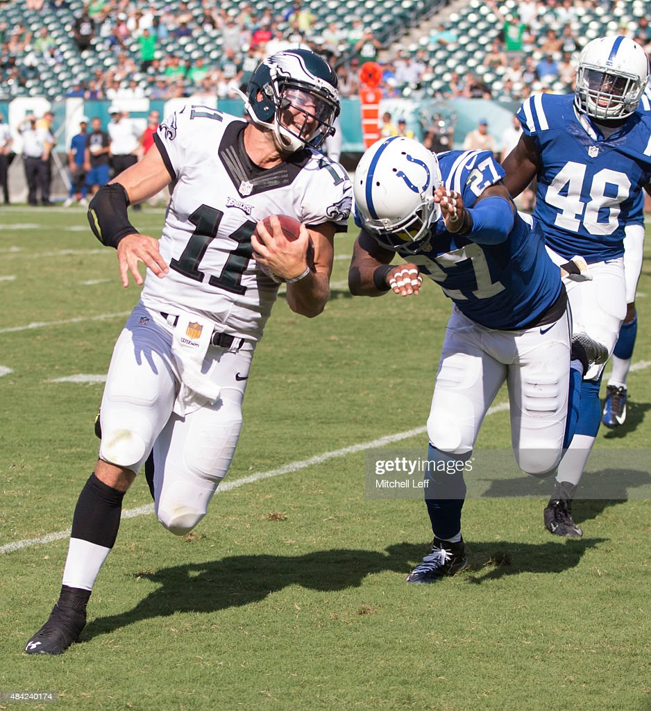 Tim Tebow #11 of the Philadelphia Eagles runs past Winston Guy #27 of the Indianapolis Colts to score a touchdown in the fourth quarter on August 16, 2015 at Lincoln Financial Field in Philadelphia, Pennsylvania. The Eagles defeated the Colts 36-10.