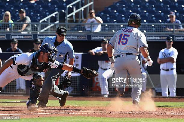 Tim Tebow of the Scottsdale Scorpions scores a run against the Peoria Javelinas during the Arizona Fall League game at Peoria Stadium on October 13...