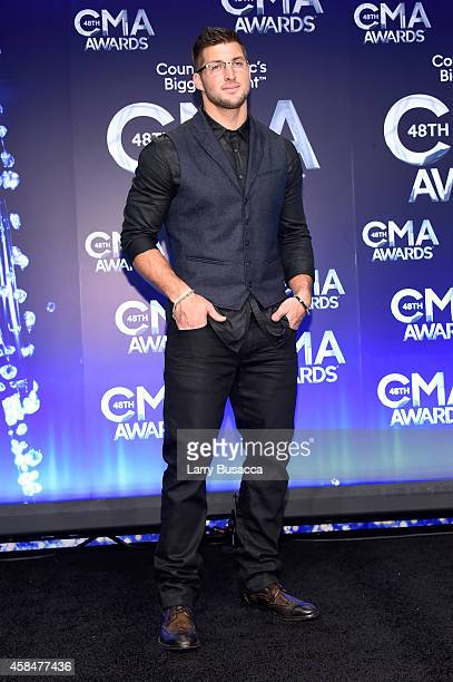 Tim Tebow poses in the press room during the 48th annual CMA Awards at the Bridgestone Arena on November 5 2014 in Nashville Tennessee