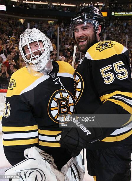 Tim Thomas and Johnny Boychuk of the Boston Bruins celebrate their 1 to 0 win over the Tampa Bay Lightning in Game Seven of the Eastern Conference...