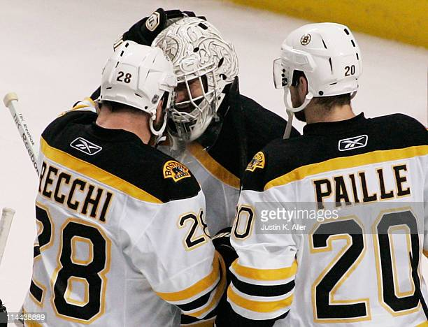 Tim Thomas celebrates with Mark Recchi and Daniel Paille of the Boston Bruins after they defeated the Tampa Bay Lightning 2 to 0 in Game Three of the...