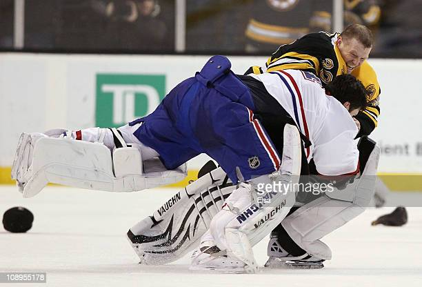 Tim Thomas of the Boston Bruins and Carey Price of the Montreal Canadiens fight in the second period on February 9, 2011 at the TD Garden in Boston,...