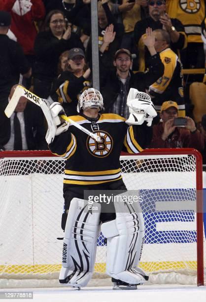 Tim Thomas of the Boston Bruins celebrates the win over the Toronto Maple Leafs on October 20 2011 at TD Garden in Boston Massachusetts The Boston...
