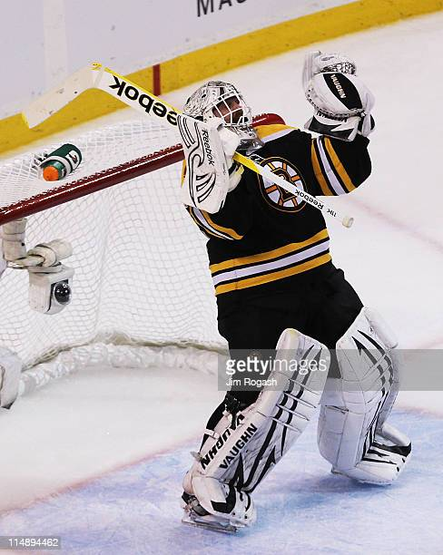 Tim Thomas of the Boston Bruins celebrates their 1 to 0 win over the Tampa Bay Lightning in Game Seven of the Eastern Conference Finals during the...