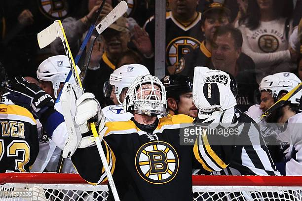 Tim Thomas of the Boston Bruins celebrates their 3 to 1 victory over the Tampa Bay Lightning in Game Five of the Eastern Conference Finals during the...