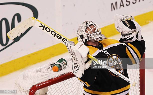 Tim Thomas of the Boston Bruins celebrates their 6 to 5 win over the Tampa Bay Lightning in Game Two of the Eastern Conference Finals during the 2011...