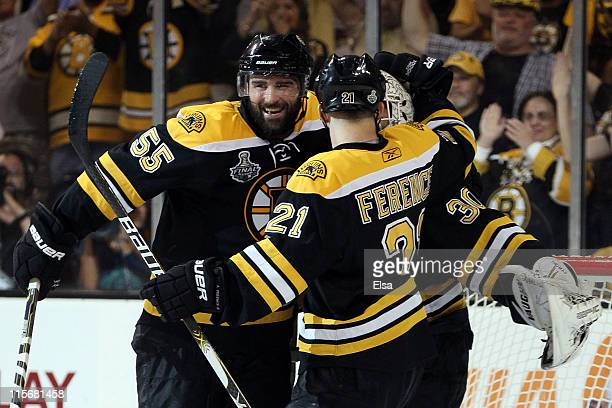 Tim Thomas of the Boston Bruins celebrates with his teammates Johnny Boychuk and Andrew Ference after defeating the Vancouver Canucks in Game Four of...