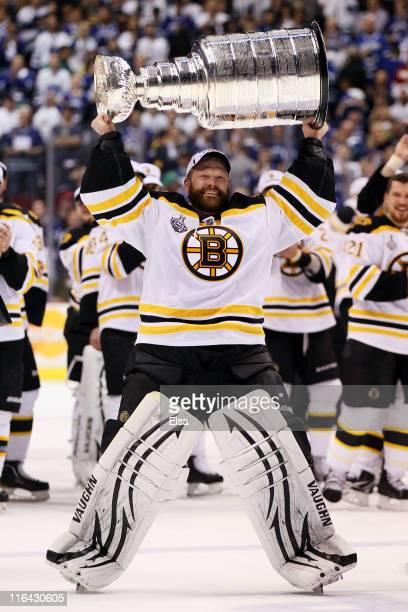 Tim Thomas of the Boston Bruins celebrates with the Stanley Cup after defeating the Vancouver Canucks in Game Seven of the 2011 NHL Stanley Cup Final...