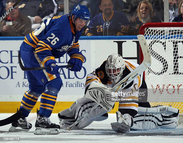 Tim Thomas of the Boston Bruins covers the puck as Thomas Vanek of the Buffalo Sabres looks for a rebound at the HSBC Arena on November 3, 2010 in...