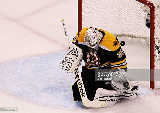 Tim Thomas of the Boston Bruins fails to block a second period goal shot by Vincent Lecavalier of the Tampa Bay Lightning in Game Two of the Eastern...