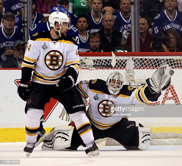 Tim Thomas of the Boston Bruins makes a glove save against the Vancouver Canucks during Game Five of the 2011 NHL Stanley Cup Final at Rogers Arena...