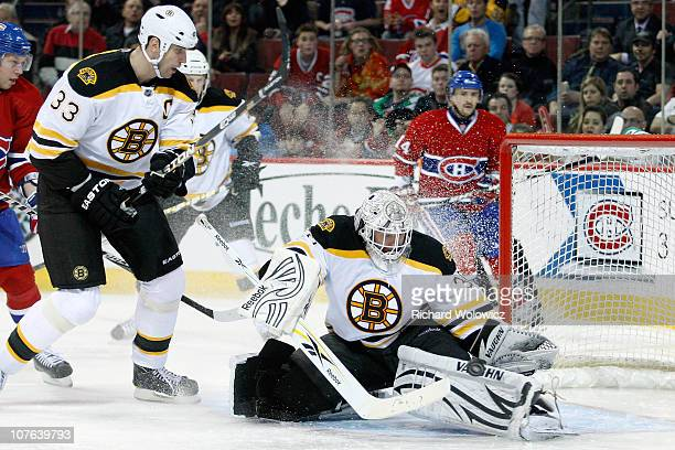Tim Thomas of the Boston Bruins makes a pad save on the puck during the NHL game against the Montreal Canadiens at the Bell Centre on December 16...
