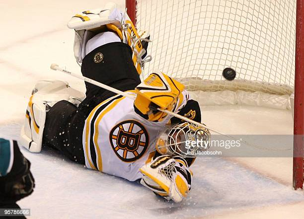 Tim Thomas of the Boston Bruins makes a save against the San Jose Sharks during an NHL game at the HP Pavilion on January 14 2010 in San Jose...