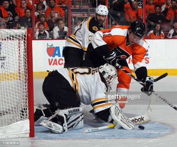 Tim Thomas of the Boston Bruins makes the save on James van Riemsdyk of the Philadelphia Flyers in Game One of the Eastern Conference Semifinals...