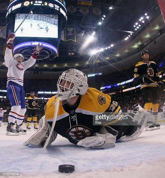 Tim Thomas of the Boston Bruins reacts after Yannick Weber of the Montreal Canadiens scored the third goal of the game in Game Two of the Eastern...