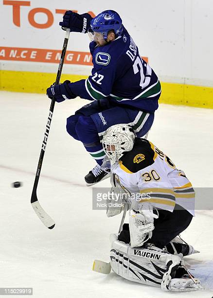 Tim Thomas of the Boston Bruins tends goal against Daniel Sedin of the Vancouver Canucks during game one of the 2011 NHL Stanley Cup Finals at Rogers...