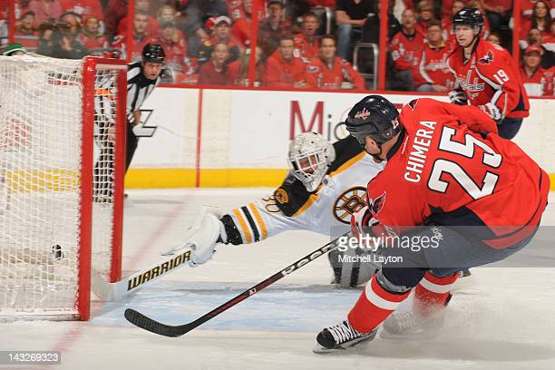 2a307b81a22 Tim Thomas of the Boston Bruins tries to make a save but Jason Chimera of  the