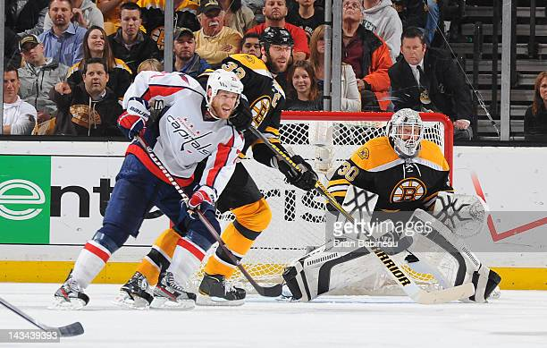 Tim Thomas of the Boston Bruins watches the play against the Washington Capitals in Game Seven of the Eastern Conference Quarterfinals during the...
