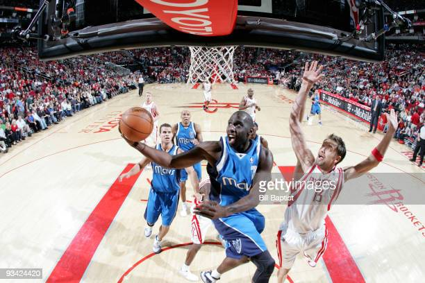 Tim Thomas of the Dallas Mavericks shoots the ball over David Anderson of the Houston Rockets on November 25 2009 at the Toyota Center in Houston...