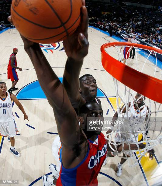 Tim Thomas of the Los Angeles Clippers attempts to dunk the ball against Damien Wilkins the Oklahoma City Thunder at the Ford Center on November 19...