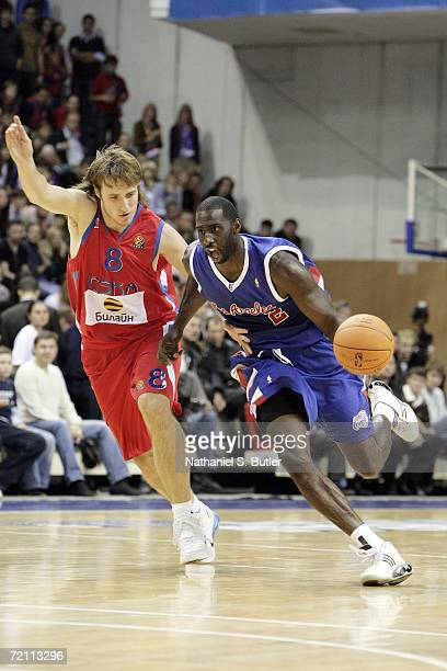 Tim Thomas of the Los Angeles Clippers drives against the CSKA at Universal Sports Hall CSKA during the NBA Europe Live Tour on October 7, 2006 in...