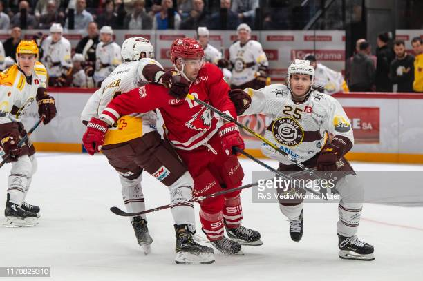 Tim Traber of Lausanne HC clashes with Roger Karrer of GeneveServette HC during the Swiss National League game between Lausanne HC and GeneveServette...