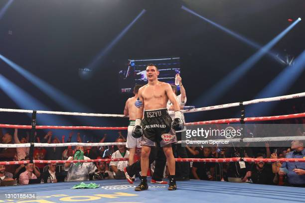 Tim Tszyu reacts after Dennis Hogan's team throw his towel in the ring during the WBO Global Super Welterweight title fight between Tim Tszyu and...