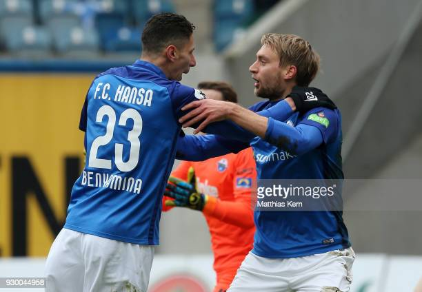 Tim Vaeyrynen of Rostock jubilates with team mate Soufian Benyamina after scoring the first goal during the 3Liga match between FC Hansa Rostock and...