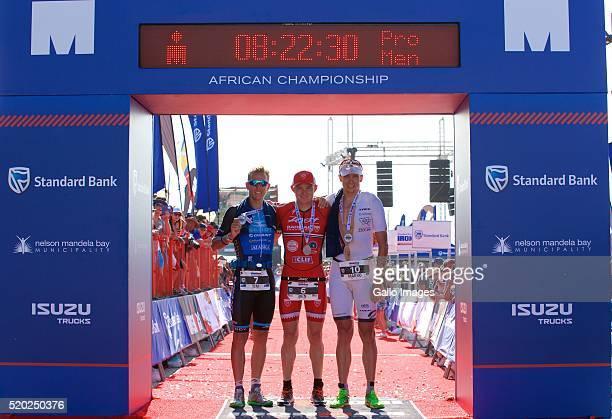 Tim Van Berkel winner Ben Hoffman and Marko Albert during the Standard Bank Ironman South Africa at Nelson Mandela Bay Stadium on April 10 2016 in...