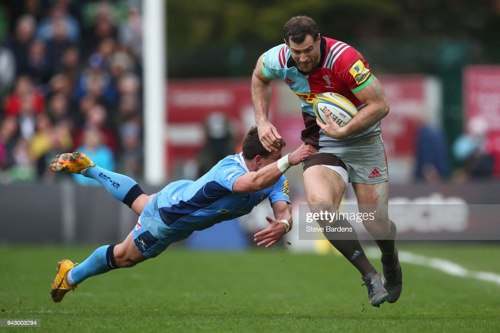 Tim Visser of Harlequins breaks the tackle of Piet van Zyl of London Irish during the Aviva Premiership match between Harlequins and London Irish at Twickenham Stoop on April 7, 2018 in London, England.