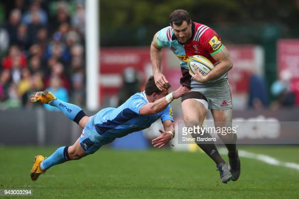 Tim Visser of Harlequins breaks the tackle of Piet van Zyl of London Irish during the Aviva Premiership match between Harlequins and London Irish at...