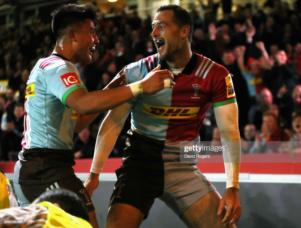 Tim Visser(R) of Harlequins celebrates with team mate Marcus Smith after scoring the first try during the Aviva Premiership match between Harlequins and Sale Sharks Sharks at Twickenham Stoop on October 6, 2017 in London, England.