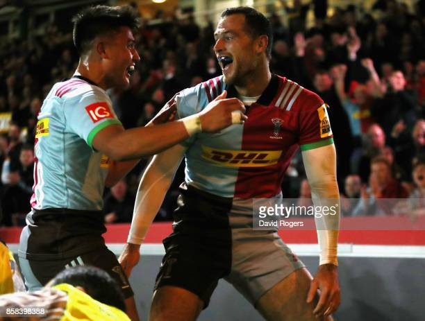Tim Visser of Harlequins celebrates with team mate Marcus Smith after scoring the first try during the Aviva Premiership match between Harlequins and...