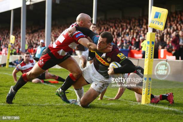 Tim Visser of Harlequins dives across the line to touch down a try during the Aviva Premiership match between Gloucester Rugby and Harlequins at...