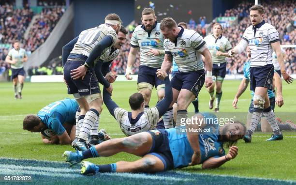 Tim Visser of Scotland celebrates scoring Scotland's third try during the RBS Six Nations Championship match between Scotland and Italy at...