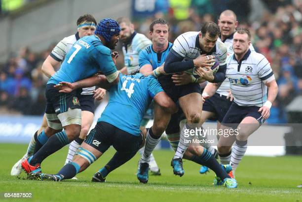 Tim Visser of Scotland drives forward during the RBS Six Nations Championship match between Scotland and Italy at Murrayfield Stadium on March 18,...