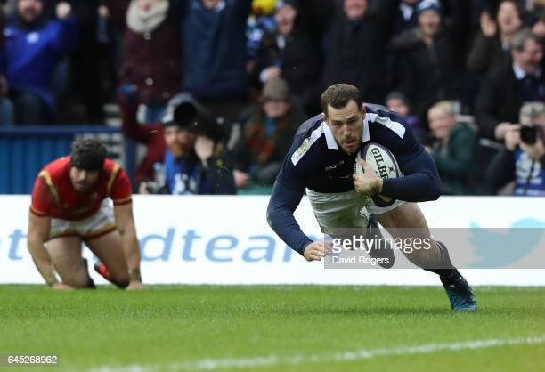 Tim Visser of Scotland goes past Leigh Halfpenny of Wales to score his team's second try during the RBS Six Nations match between Scotland and Wales...
