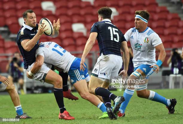 Tim Visser of Scotland is tackled by Michele Campagnaro of Italy during their rugby test match between Italy against Scotland at the National Stadium...