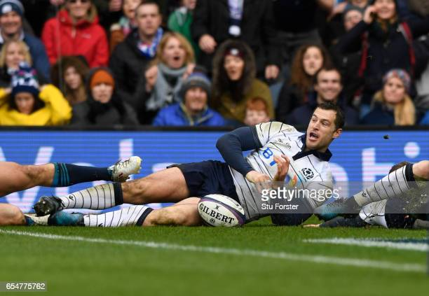 Tim Visser of Scotland scores his team's third try during the RBS Six Nations match between Scotland and Italy at Murrayfield Stadium on March 18,...