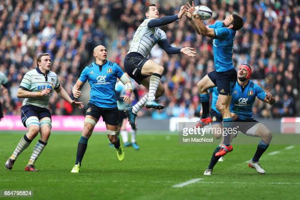 Tim Visser of Scotland vies with Edoardo Padovani of Italy during the RBS Six Nations Championship match between Scotland and Italy at Murrayfield...