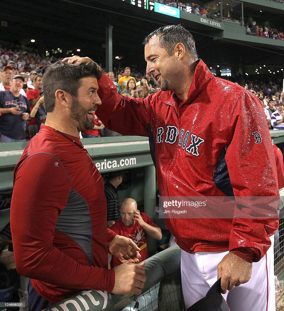 Tim Wakefield #49 of the Boston Red Sox reacts with teammate Jason Varitek #33 of the Boston Red Sox after earning his 200th win after a game with the Toronto Blue Jays at Fenway Park on September 13, 2011 in Boston, Massachusetts.