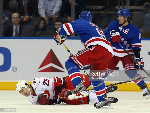 Tim Wallace of the Carolina Hurricanes goes down to block a shot by Dan Girardi of the New York Rangers during the first period at Madison Square...